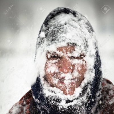 man in a snowstorm outside being more energy efficient